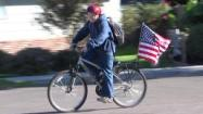 Boy with flag on bike